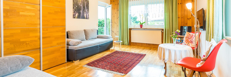 Ferienwohnung im EG: Erdgeschoss - Wohnzimmer. Haus Christine am Vogelsang, Ferienwohnungen in Lindau am Bodensee.